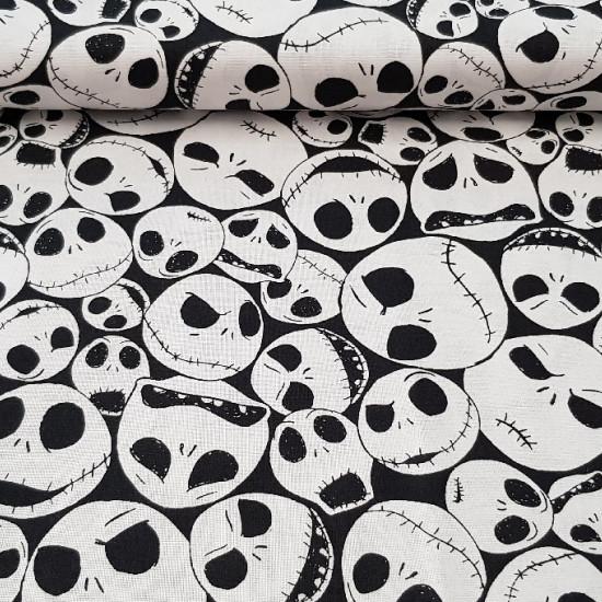 Tela Algodón Disney Jack Skelleton - Tela de algodón ideal para Halloween, con dibujos de caras de Jack Skelleton, uno de los protagonistas de la película Pesadilla antes de Navidad. El fondo de la tela es negro y las caras blancas.