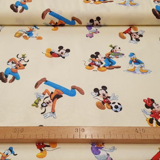 Tela Algodón Disney Mickey y Amigos - Tela de algodón infantil con los personajes de DisneyMickey, Minnie, Goofy y Donald sobre un fondo amarillo claro. La tela tiene una composición 100% algodón y mide 140cm de ancho.