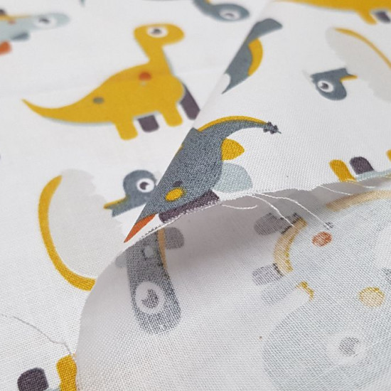 Cotton Dinosaurs Toy fabric - Children's cotton fabric with dinosaur drawings with bulging eyes in ocher and gray colors on a white background. The fabric is 150cm wide and its composition 100% cotton